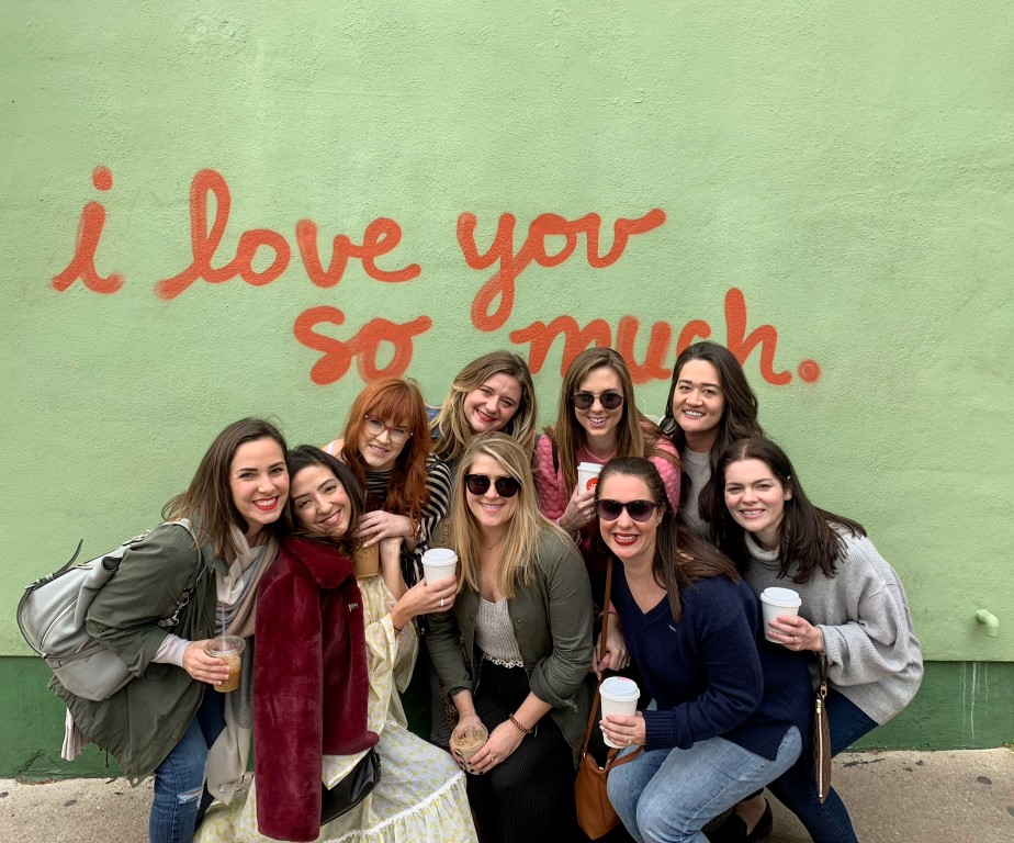 """A group of girlfriends in front of the Austin """"I love you so much"""" mural."""