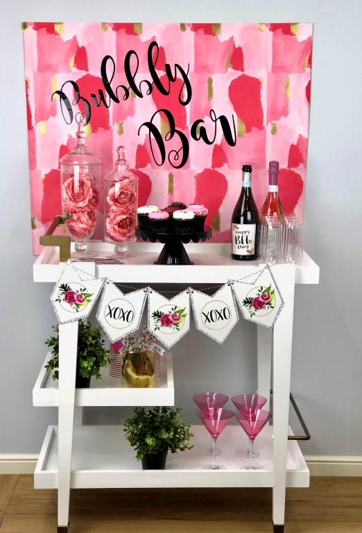 A bubbly bar is perfect for a Galentine's Day gathering with an easy DIY backdrop and party printables.