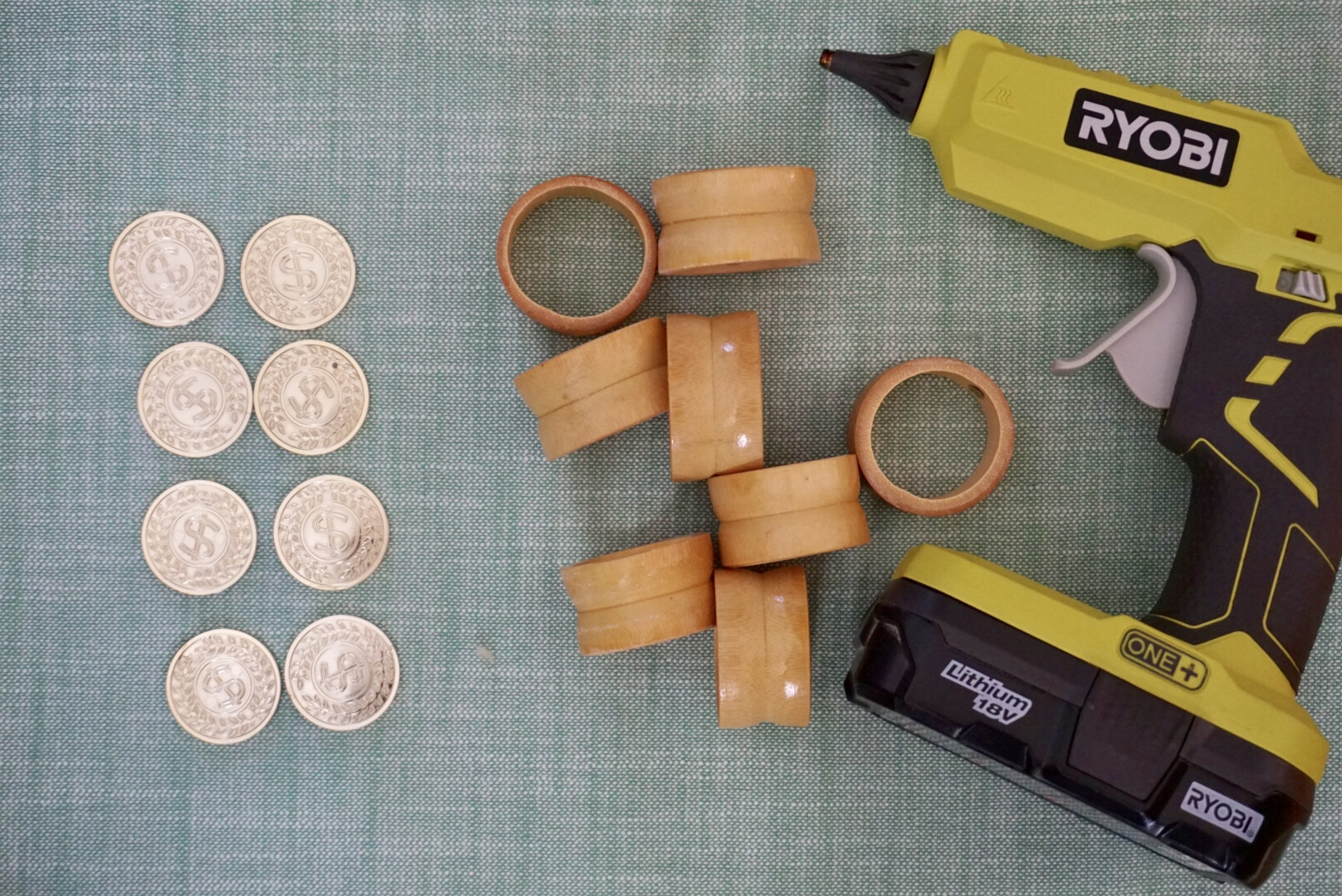 Gold coins and wood napkin rings make a perfect St. Patrick's Day table setting detail.