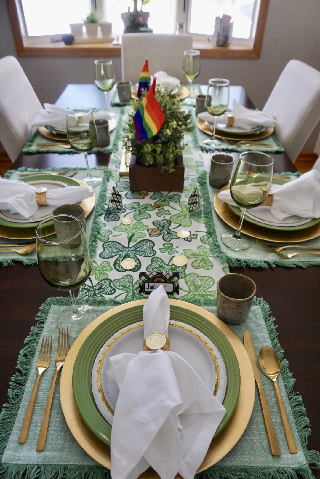St. Patrick's Day tablescape with gold chargers, green plates, and gold accents.