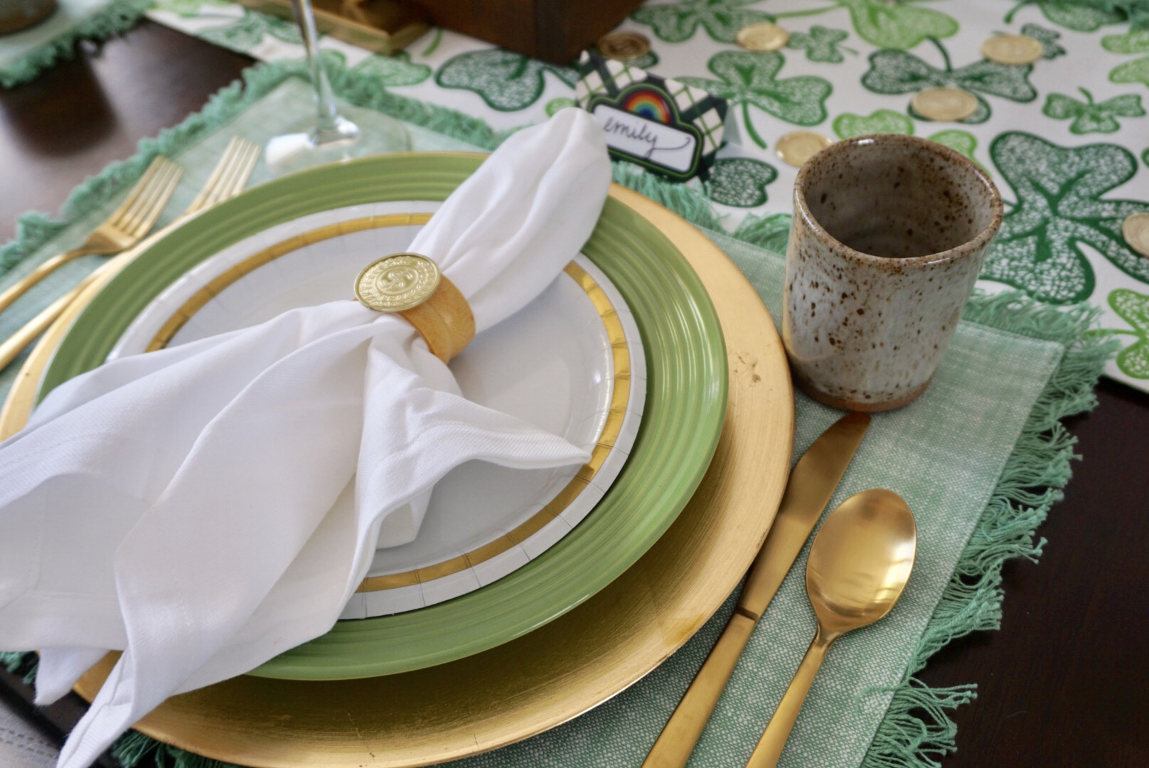 DIY gold coin napkin rings for St. Patrick's Day dinner table.
