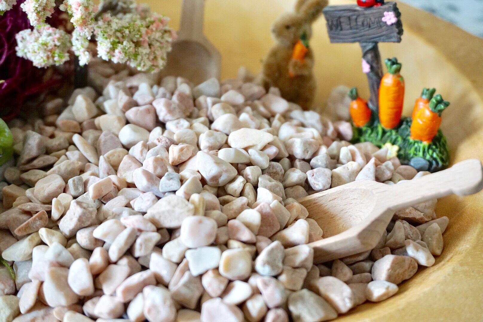 Pink rock from Michaels makes a great base for DIY mason jar fairy garden terrariums.