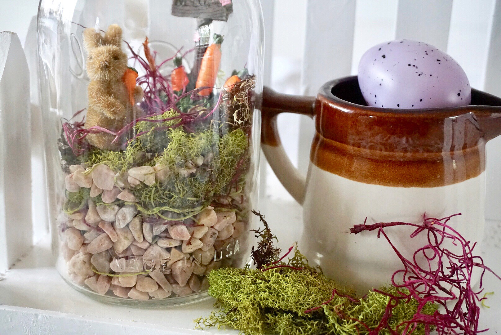 Easter themed fairy garden with bunny and carrot patch