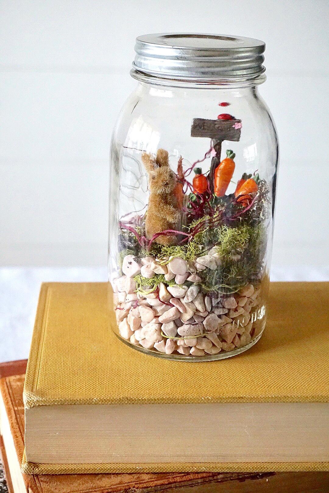 DIY Mason Jar Easter Fairy Garden Terrarium made with bunny figurines and moss.