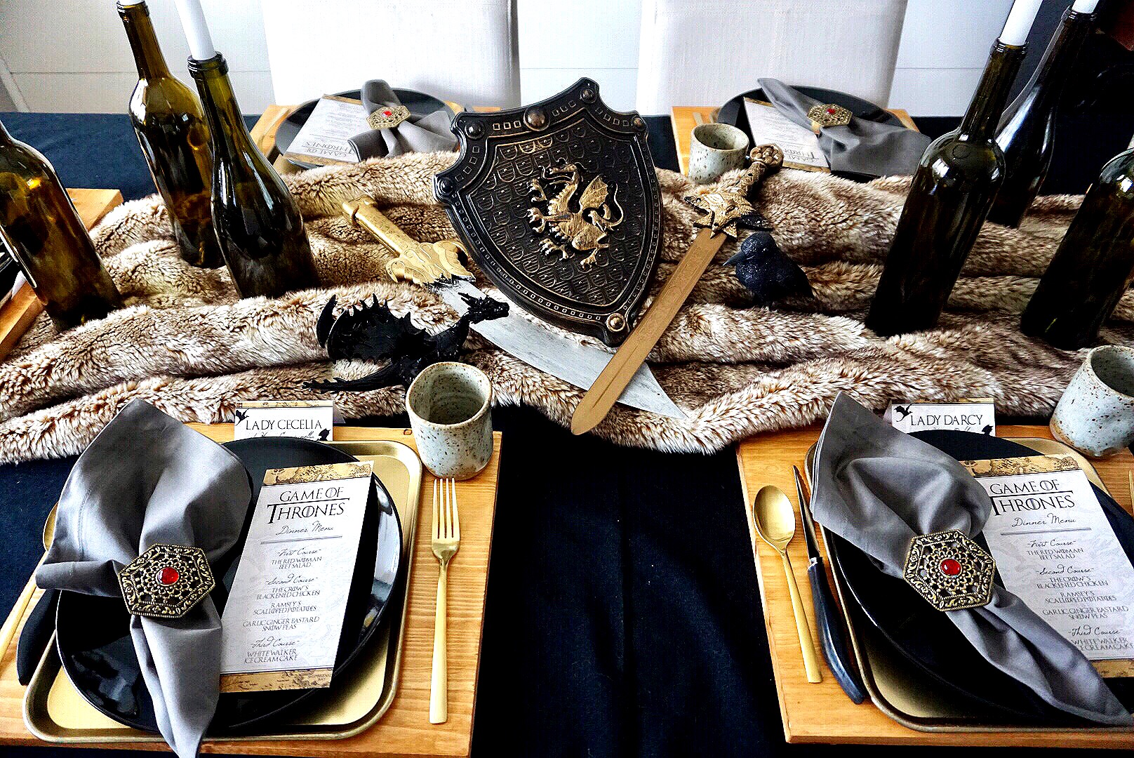 A fur blanket can double as a table runner for a Game of Thrones dinner party.