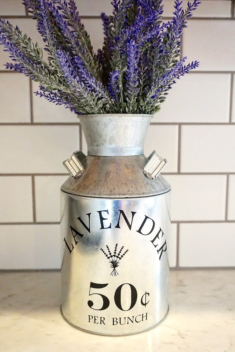 Galvanized milk jug filled with lavender.