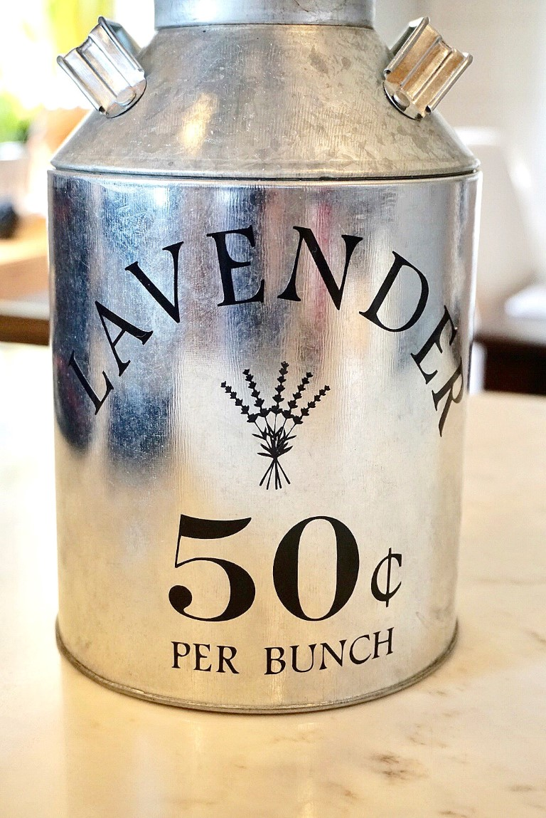 Lavender 50 cents per punch on galvanized metal milk jug.