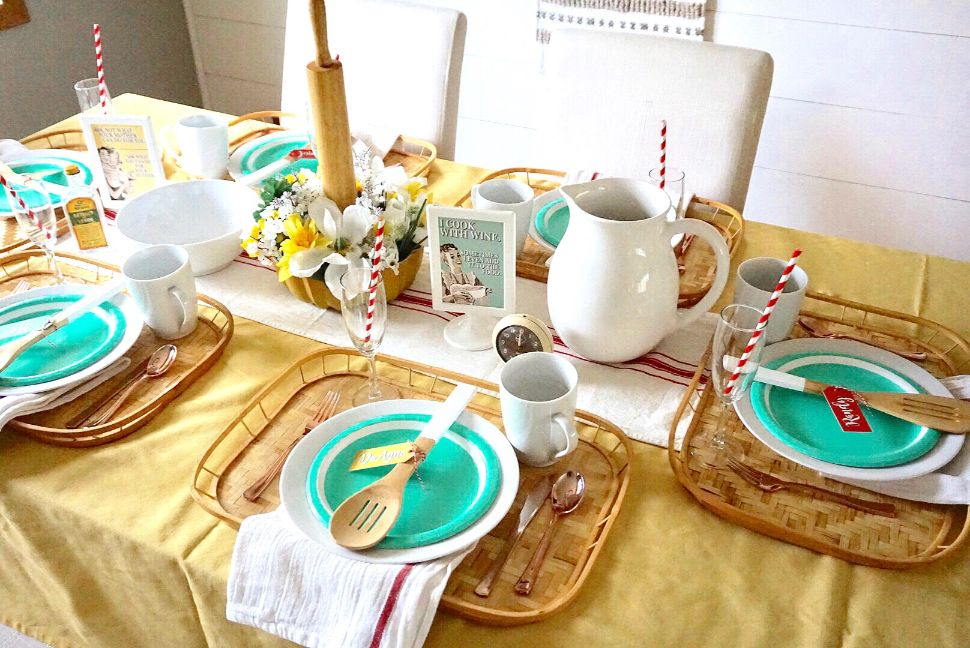 Vintage themed Mother's Day brunch with yellow tablecloth, bamboo trays, wooden utensils, and aqua plates.