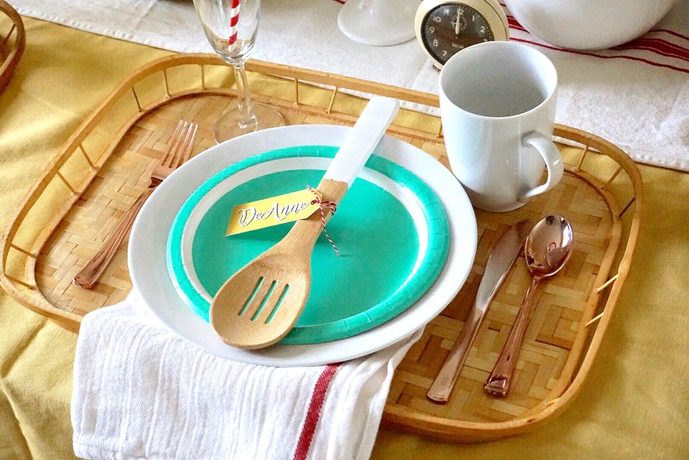 Vintage bamboo tray with white plate, flour sack napkin, and aqua blue or mint paper plate for Mother's Day brunch.