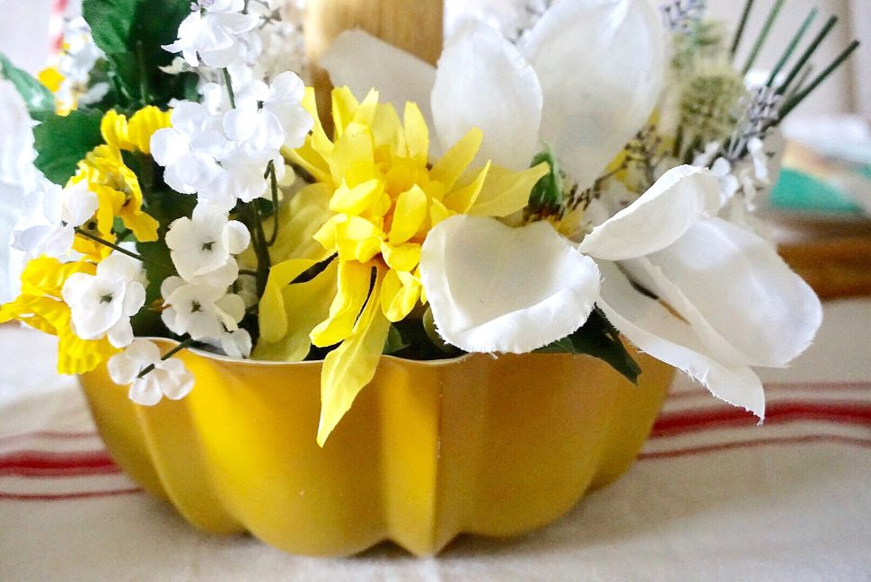 Dollar store floral for Mother's day centerpiece in yellow and white.