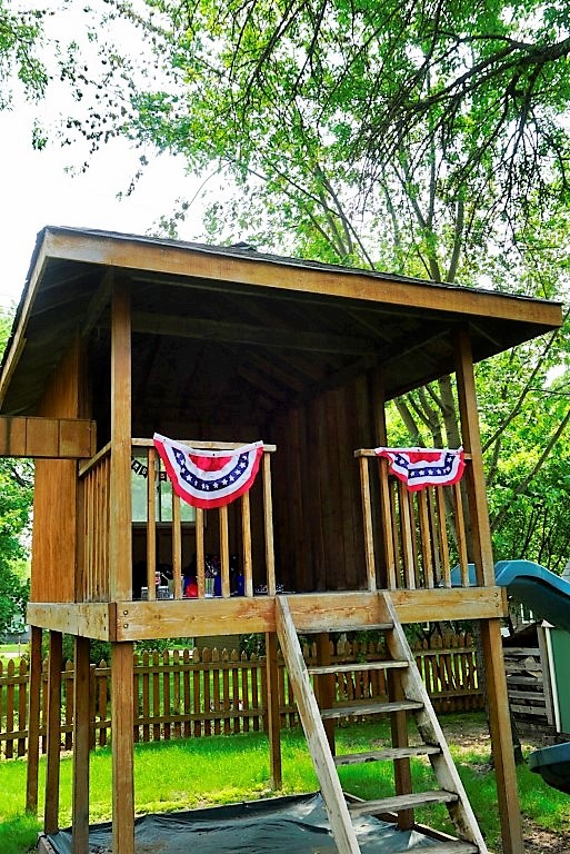 Kids playhouse decorated for 4th of July