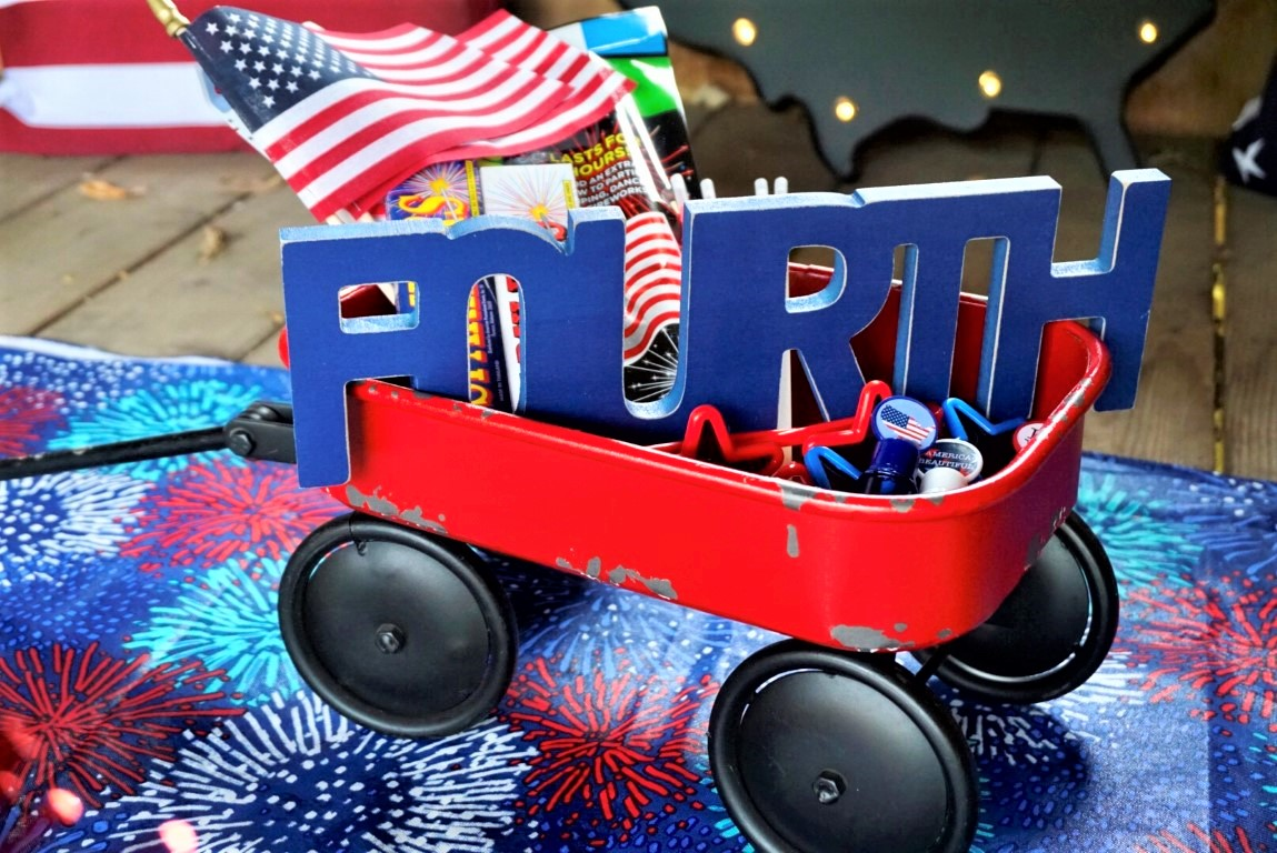 Little red wagon filled with 4th of July kids activities.