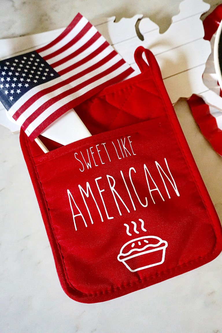 Red dollar store oven mitt with 4th of July design ironed on with Cricut Easy Press.