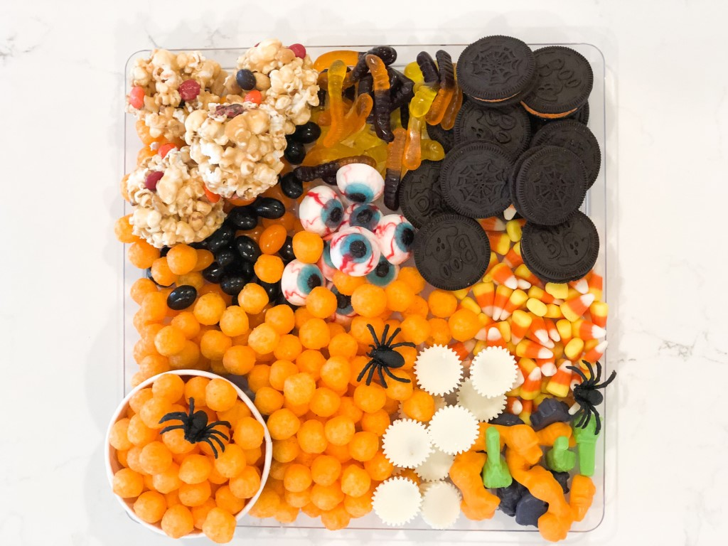 Halloween charcuterie snack board with candy and cheeseballs