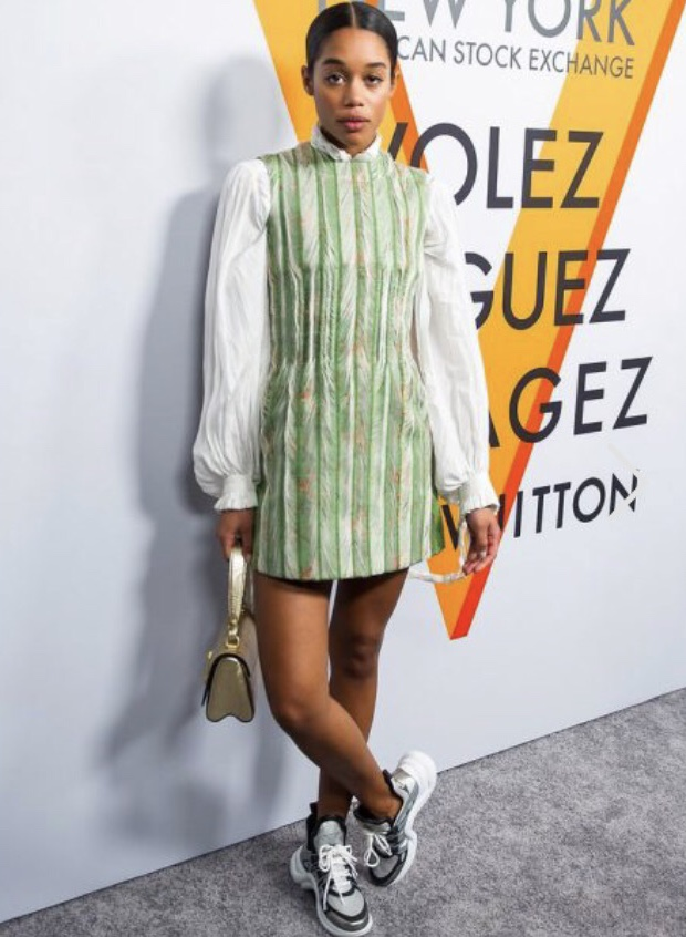 One Word: CHIC - Use your chicest, most put together high fashion piece and add your chunky sneakers for a really diva look.-Laura Harrier