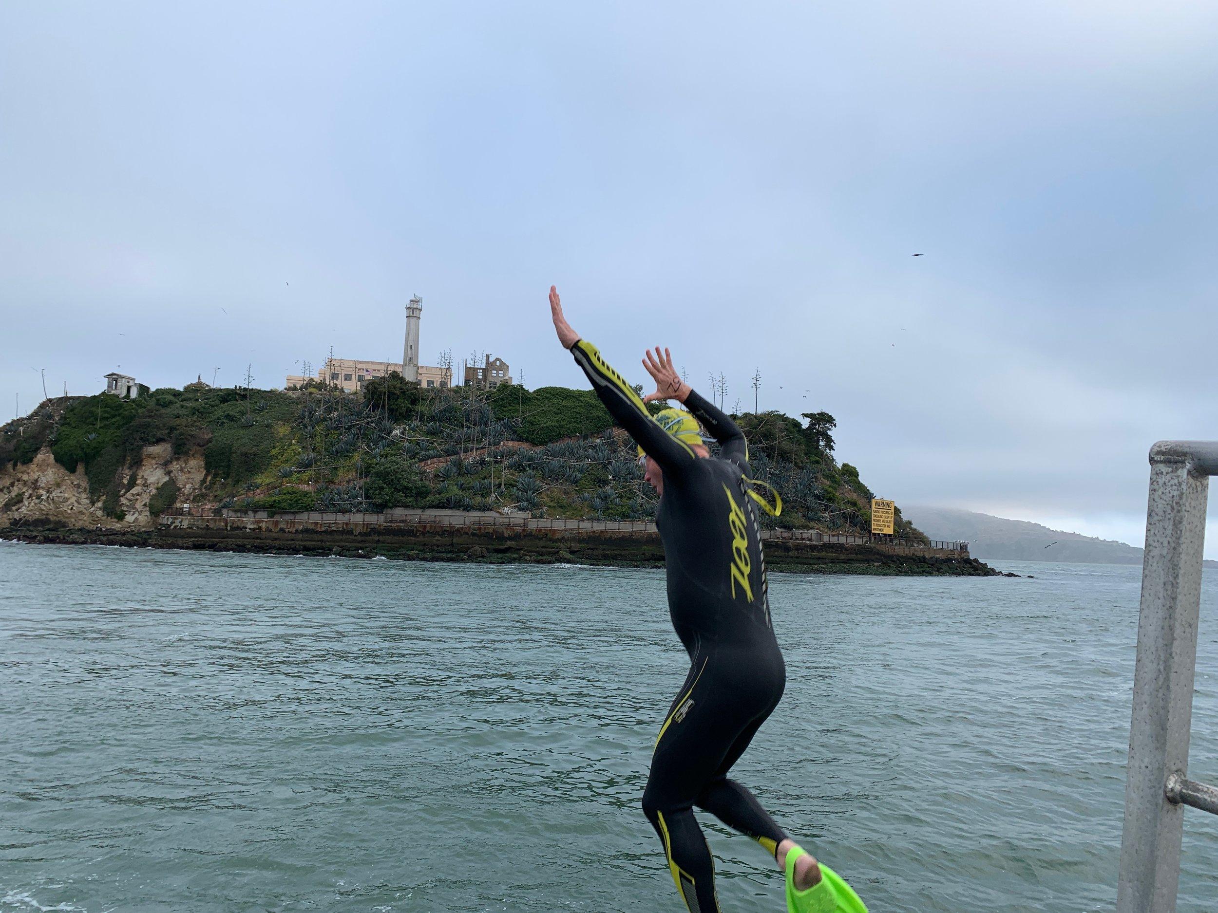 Jumping in Alcatraz Odyssey Swim September