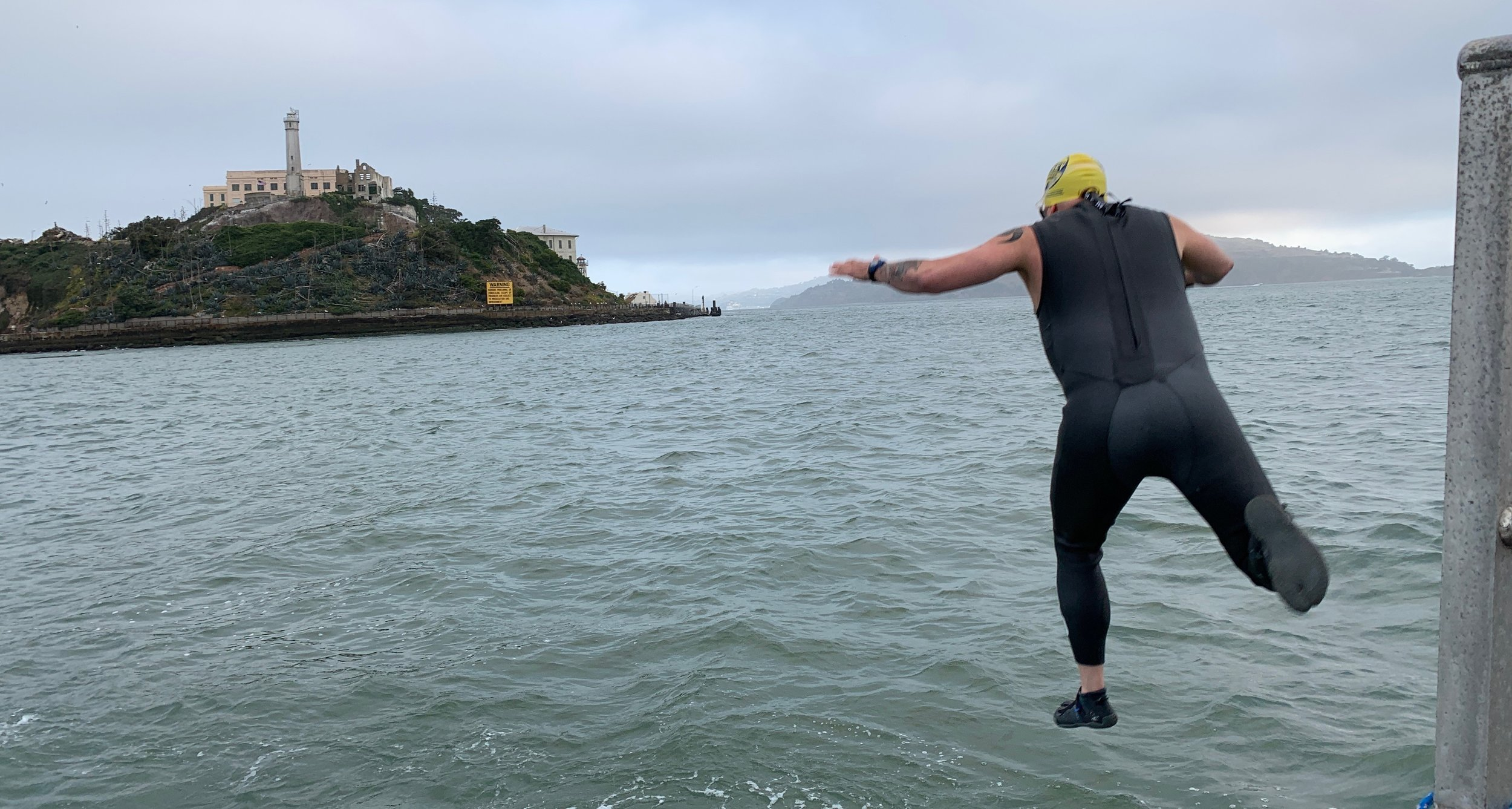 Jumping in Alcatraz Open Water Swimming Odyssey