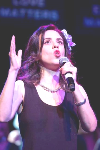 Daughter Jen, singing at Glide Memorial where she is a member of the Glide Ensemble and soloist.