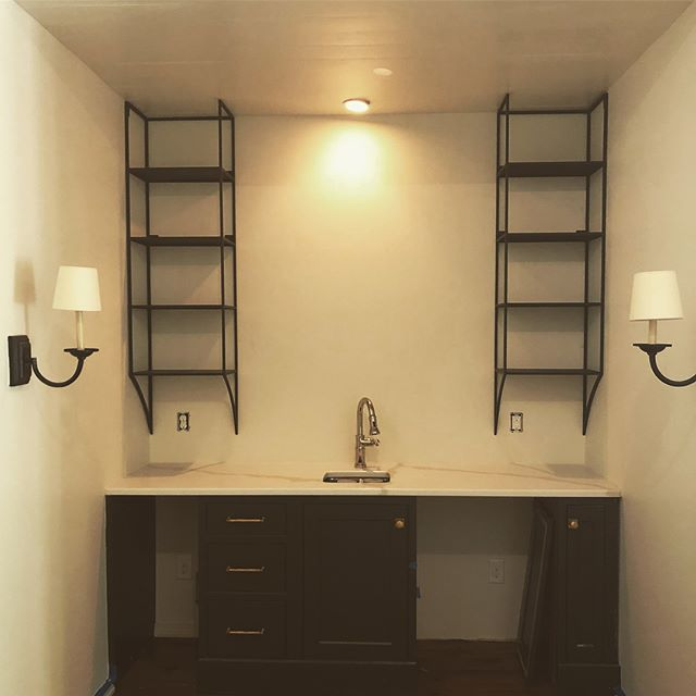 You're not seeing double. These twin #bar #shelves may look plain, but get a little closer and you'll see the all the tasty hand made stuff. What do you guys think?