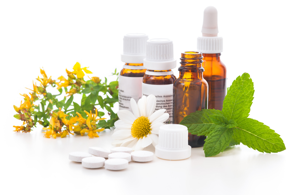 mint herbs and flowers in small medicine bottles for natural medicine