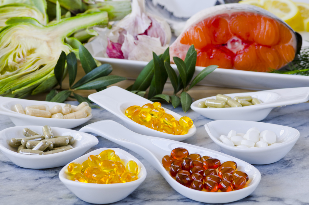 medicine capsules in dishes with artichoke and salmon