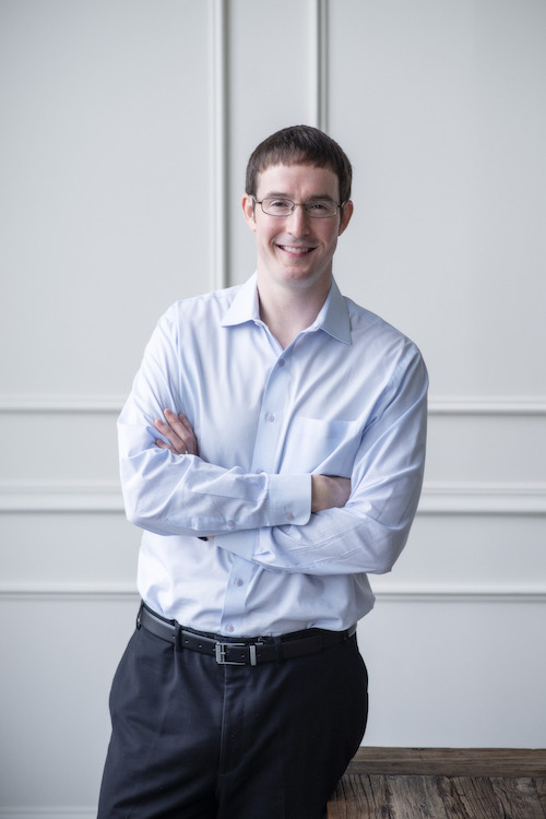ross mccallum, man smiling wearing glasses