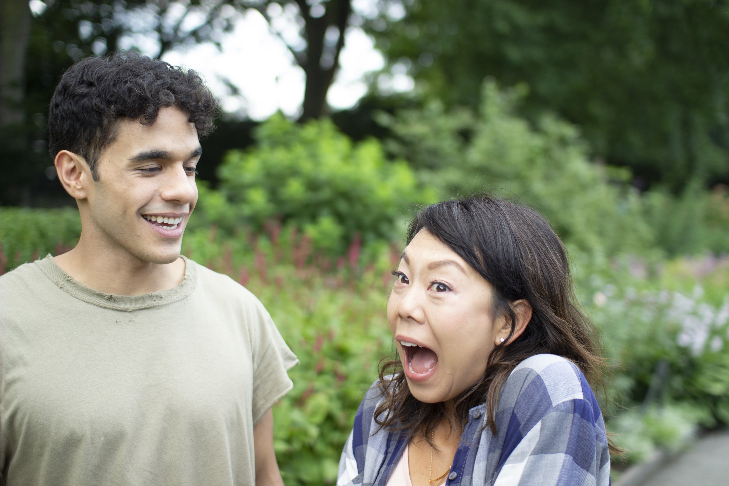 BTS of Gil Perez-Abraham (MARCO) and Ali Ahn (LIBBY). In Fort Tryon Park - Heather Gardens. Photo by Clark Burnett.