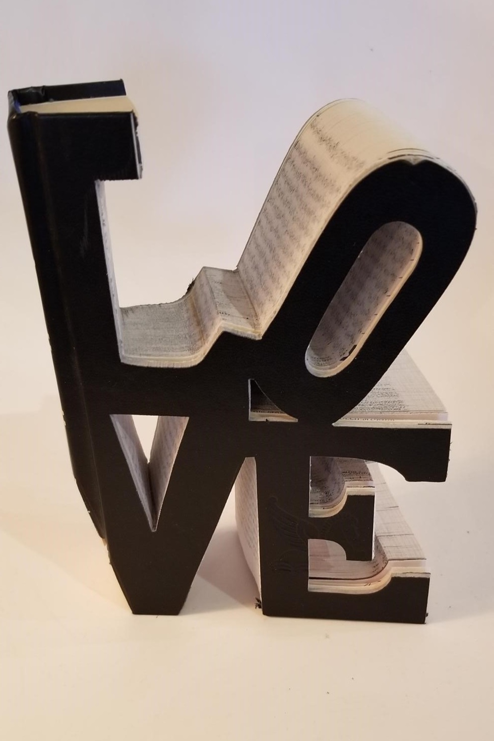 On a more whimsical note, this L-O-V-E book was rescued from the library's trash bin; an old Reader's Digest series transformed into art. We love a crafty upcycle!