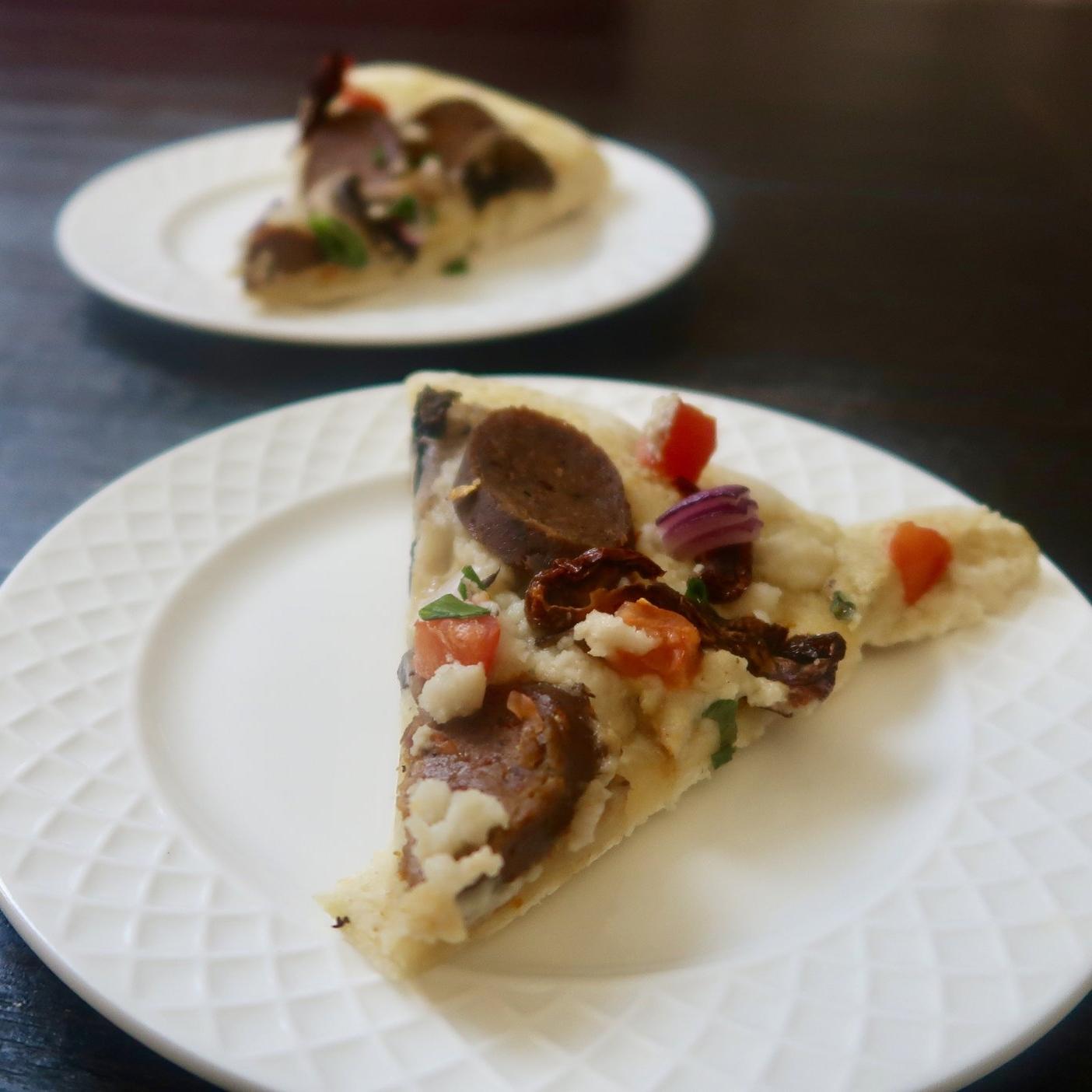 Vegan Garlic Alfredo Pizza  https://www.kristancbarril.com/blog-1/recipes/2018/10/22/garlic-alfredo-pizza-with-tofurky-italian-sausages