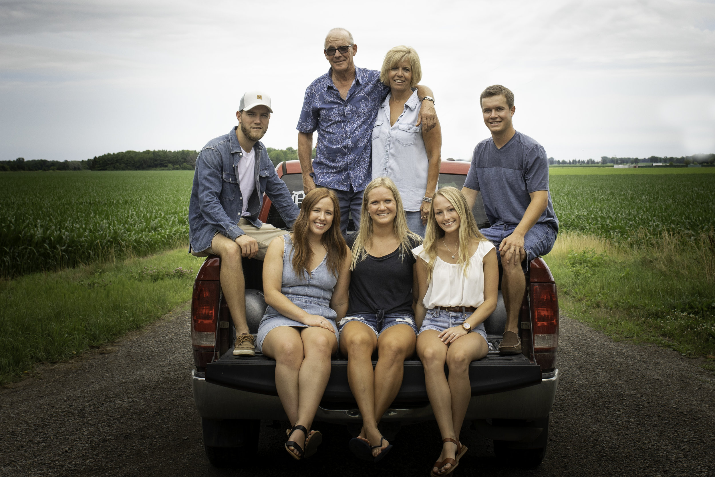 Family-agricultural-photographer-jodie-aldred-photography-rural-country-farm-farmers-ontario-london-huron-middlesex-elgin-chatham-elgin-rural-country-outdoors--corn-truck-dodge-gravel-road-summer.jpg