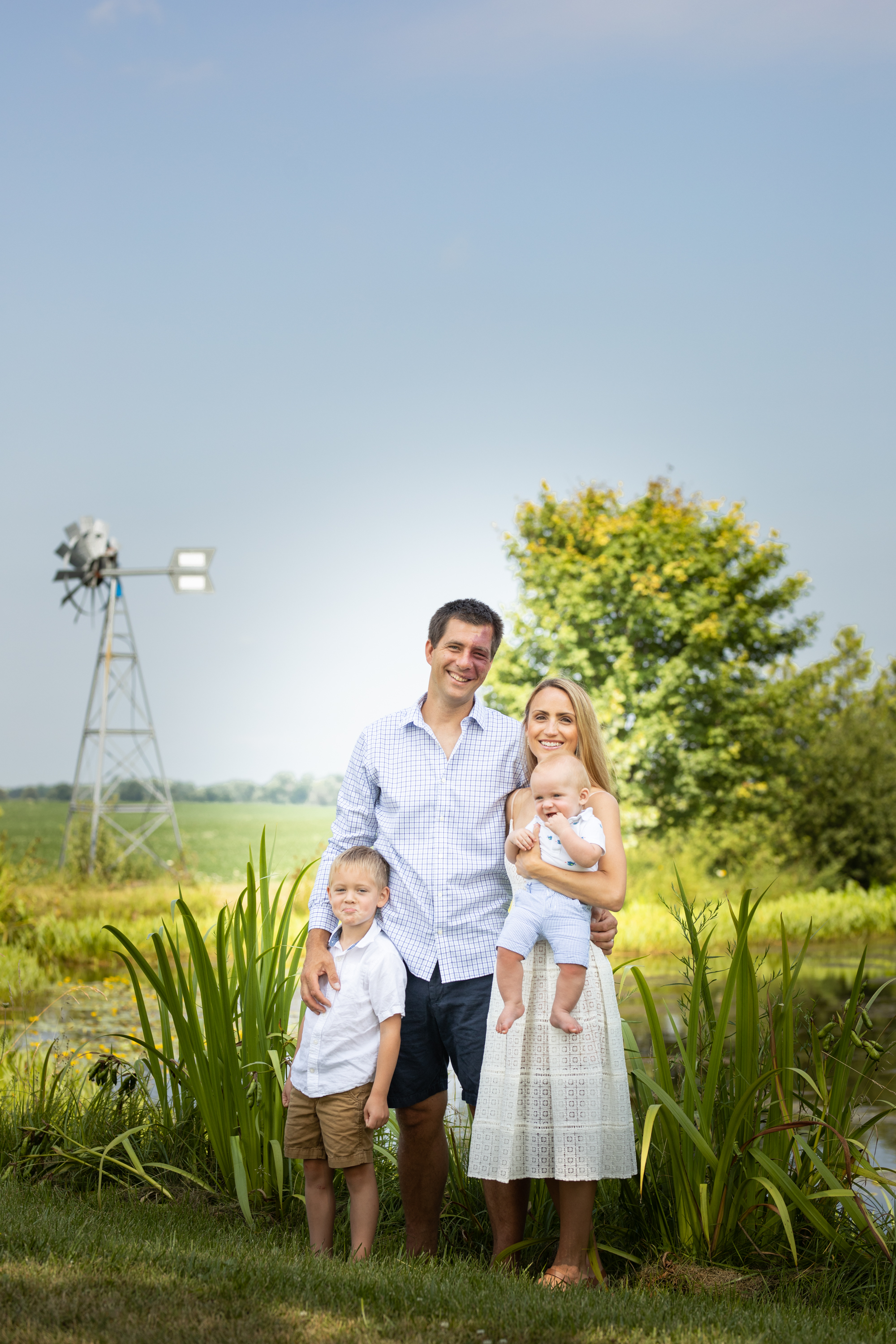 Family-agricultural-photographer-jodie-aldred-photography-rural-country-farm-farmers-ontario-london-huron-middlesex-elgin-chatham-elgin-rural-country-outdoors-windmill-pond-summer.jpg