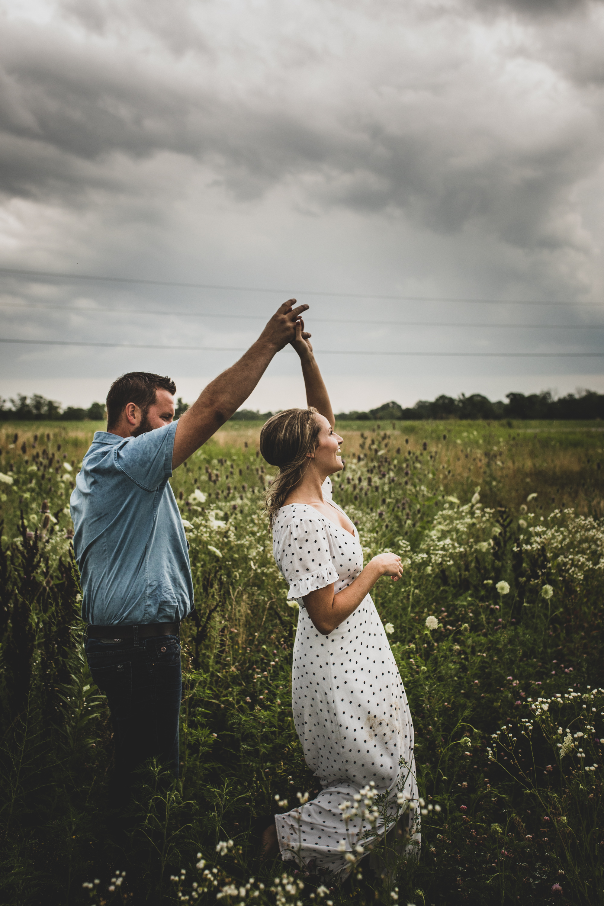 Family-agricultural-photographer-jodie-aldred-photography-rural-country-farm-farmers-ontario-london-huron-middlesex-elgin-chatham-elgin-rural-country-outdoors-wildflowers-couple-storm-summer.jpg
