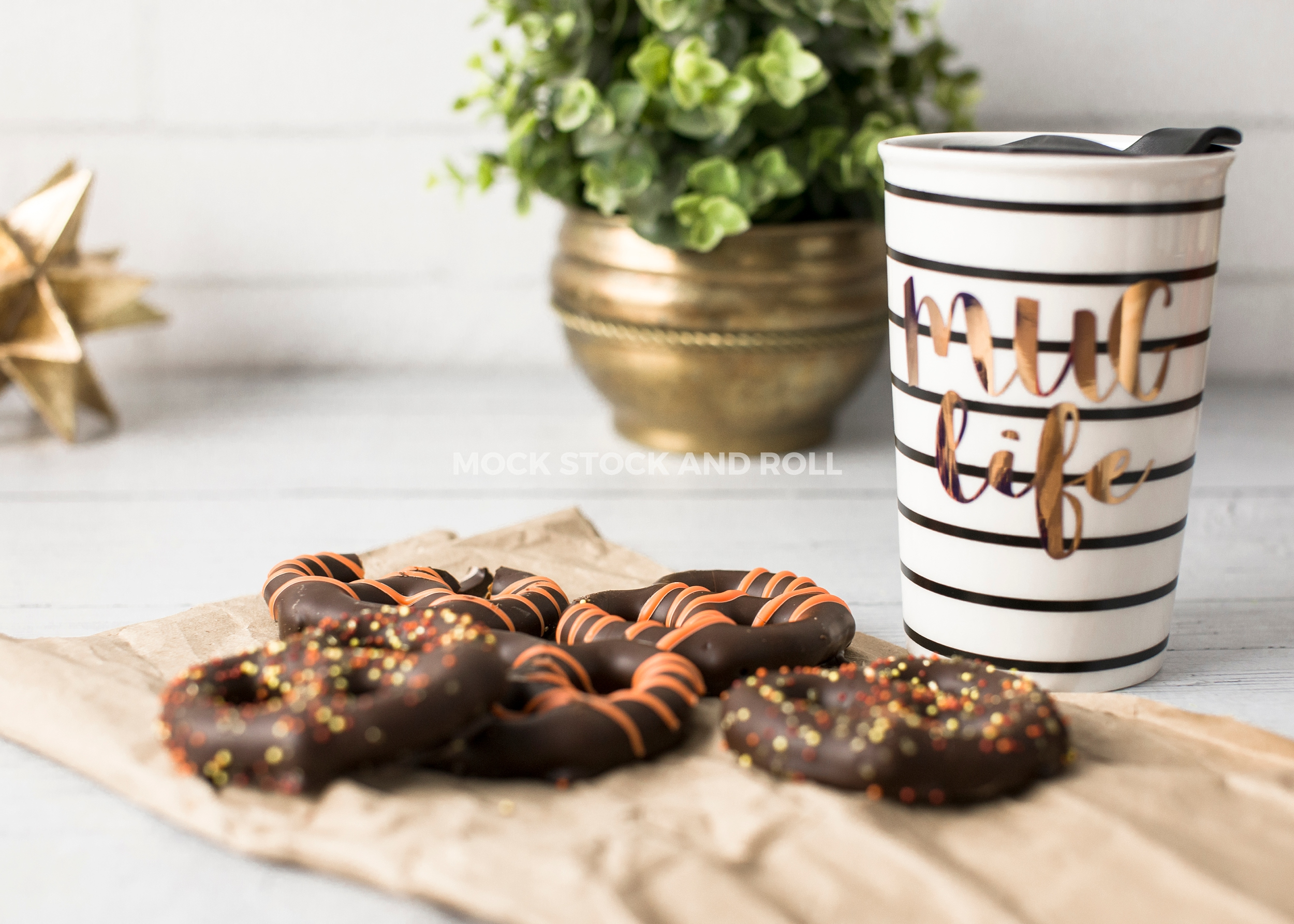 Bright fall styled stock photo of chocolate covered pretzels and a 'mug life' striped mug from Mock Stock and Roll Photography.