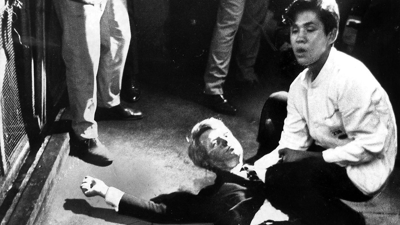 A mortally wounded senator Robert F. Kennedy is aided by Ambassador hotel busboy Juan Romero, age 17.  Romero died in October, 2018.