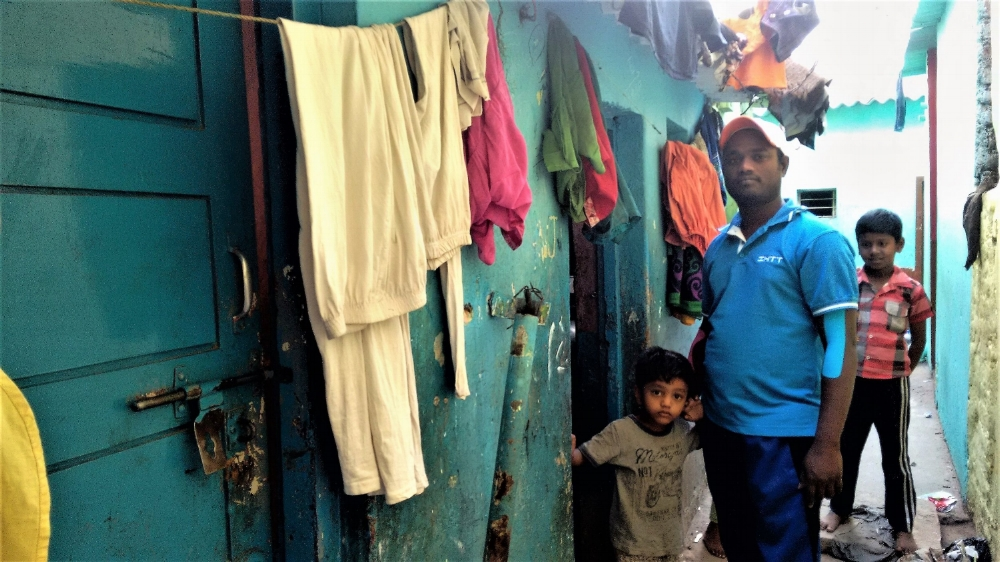 Inside a lane that's narrower than four feet is Shekar's asbestos-roofed one-room shack.