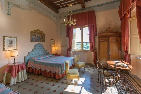 One of the bedrooms still available in our Tuscan Villa complete with 400 year old frescoes. Why not make it yours?
