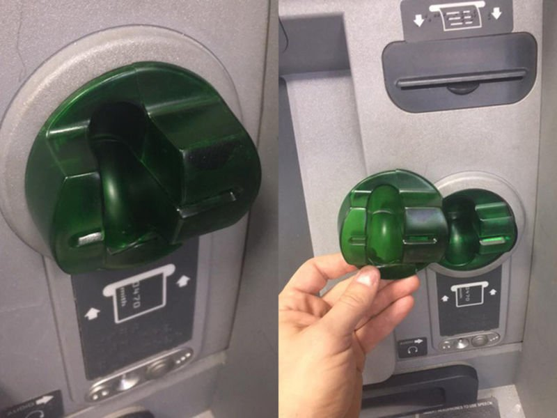 An ATM skimmer with a fake card reader over the real card reader