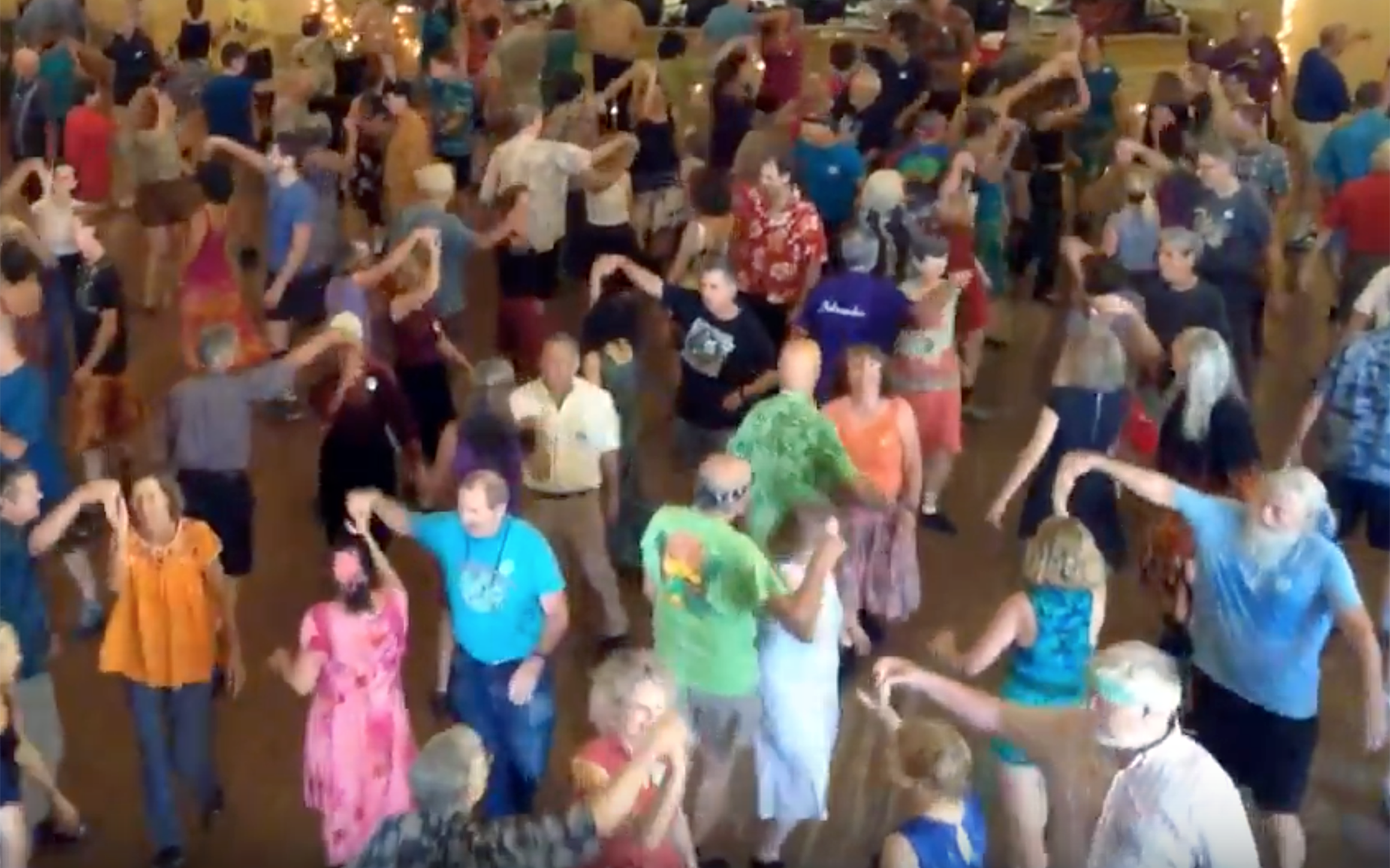 "196.CONTRA DANCE / UK / USA - CONTRA DANCE is a folk dance made up of long lines of couples. With mixed origins from English country dance, Scottish, French dance styles in the 17th century, Contra dance can be found around the world and have much popularity in North America and the United Kingdom. It is a social dance that one can attend without a partner. The dancers form couples, and the couples form sets of two couples in long lines starting from the stage and going down the length of the dance hall. Couples progress up and down these lines, dancing with each other couple in the line. The dance is led by a caller who teaches the sequence of figures in the dance before the music starts. Callers describe the series of steps called ""figures"". It takes 64 beats, after which the pattern is repeated."