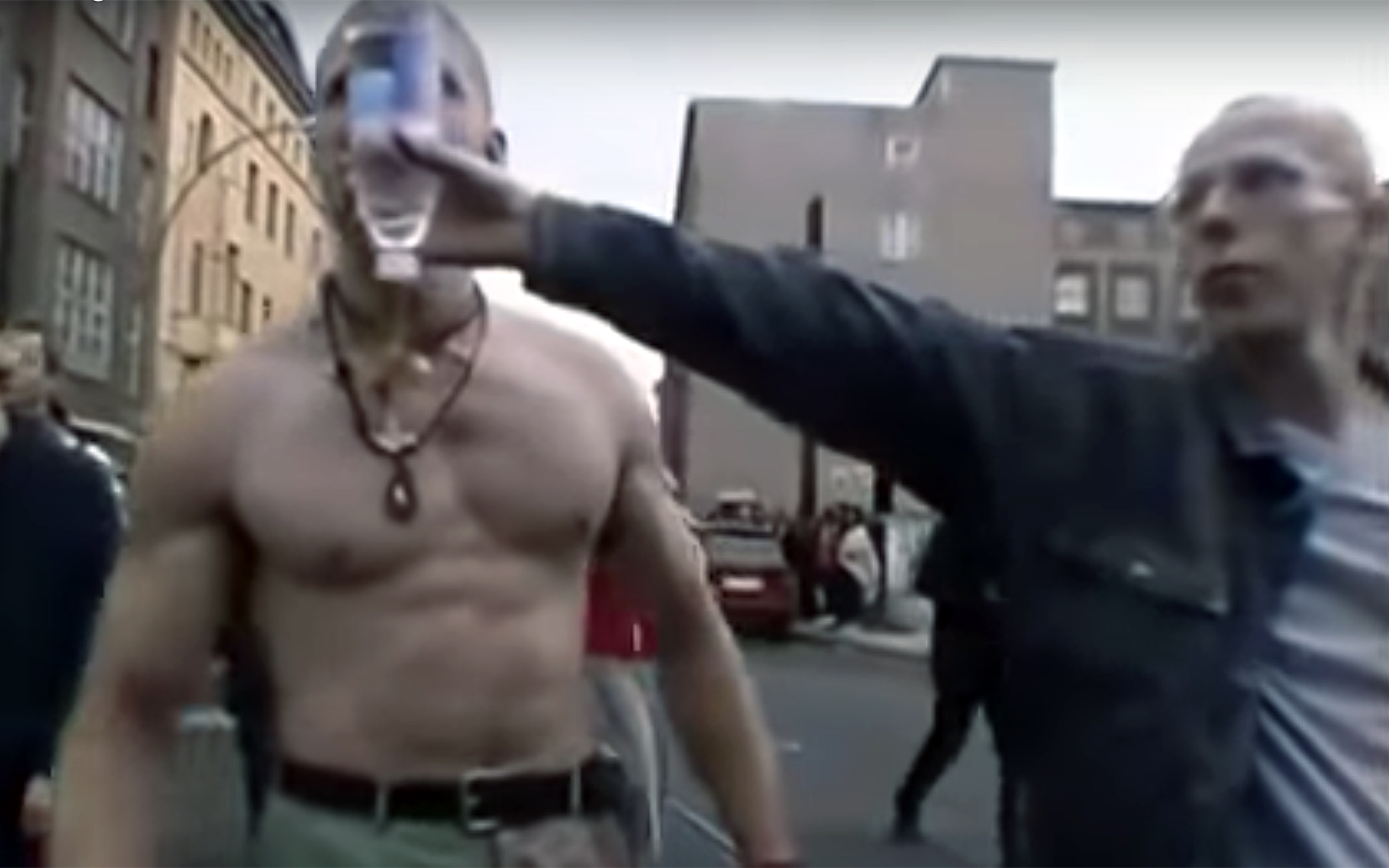 873.Techno Viking / Viral - Techno Viking is an internet phenomenon or meme based on a video from the 2000 Fuckparade in Berlin, Germany. The 4-minute video shot by experimental video artist Matthias Fritsch. The camera shows dancing people with a blue haired woman in front. A man stumbles into the scene grabbing the woman. A bare-chested man (known colloquially as the Techno Viking) enters the scene while turning to that man. He grabs him by the arms and the camera shows the confrontation. The bare-chested man pushes the guy back in the direction he came. He looks at him sternly and then points his finger at him, ensuring he behaves. Then the camera follows the bare-chested man as the techno parade continues. As the situation calms down, the bare-chested man starts to dance down Rosenthaler Straße to techno music.