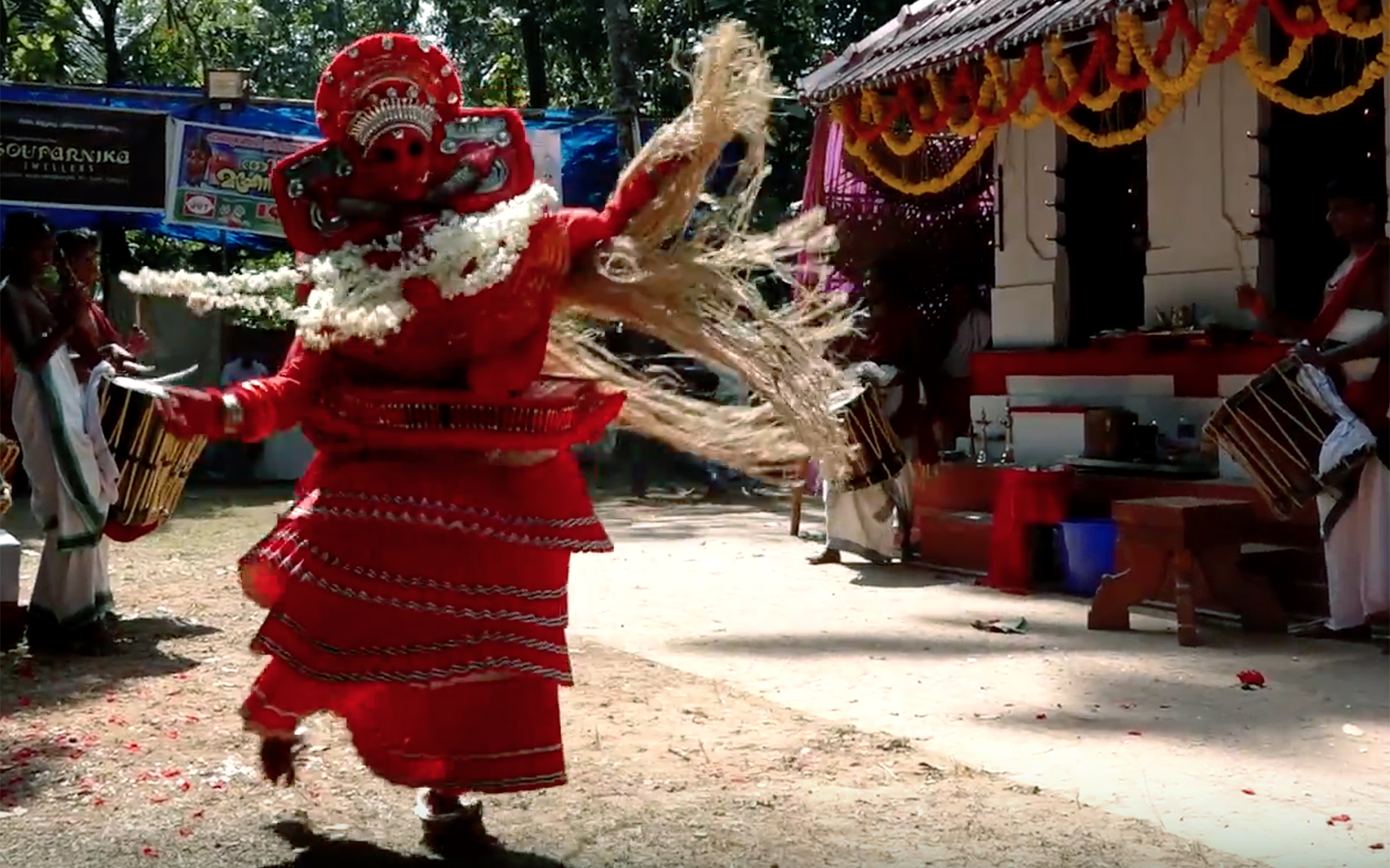 879.THEYYAM / India - THEYYAM is a popular ritual form of worship of northern part of Kerala, India, as a living cult with several thousand-year-old traditions, rituals and customs. It is a combination of ritual, theatrical and lived culture with music and elaborate costuming. Dancer acts possessed with different Hindu, Shaivite and other belief system deities. Performers belong to the lower caste community, and have an important position in Theyyam. People of these districts consider Theyyam itself as a God and they seek blessings from this Theyyam. The dance is generally performed in front of the village shrine. It is also performed in the houses as ancestor-worship. It is accompanied by the chorus of such musical instruments. There are over 400 separate Theyyams, each with their own music, style and choreography.