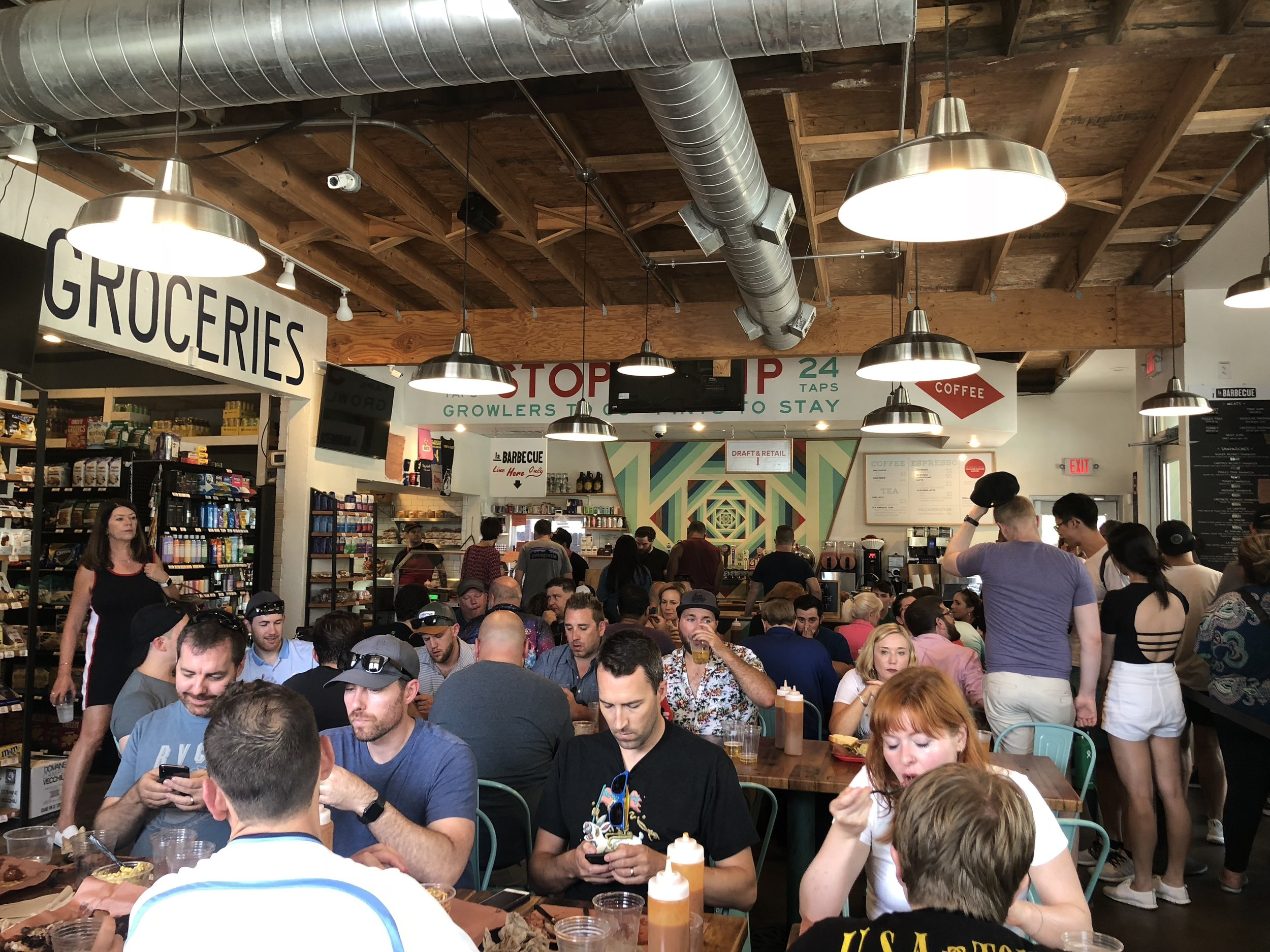 Waiting in line is OK… and when the rent is high, don't be afraid to mix uses in one place. LA Barbecue has a BBQ line, a coffee shop and a grocery store. We waited in line for over an hour for the BBQ… it was so worth it! (Women owned and locally sourced meat, I might add!)