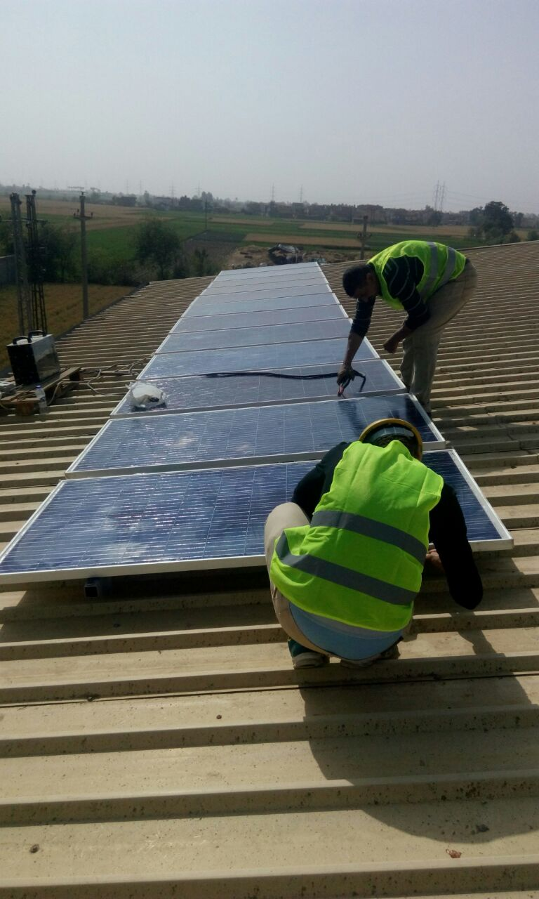 Mounting our solar modules on the roof of an Egyptian factory. This system reduced the business's electricity bill by 80%.