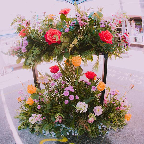 2019 New Bedford Folk Fest Installation  Roses, Snapdragon, Chrysanthemum Poms, Huck, Pine, Phoenix Palm Photo by  Rickelle Tavares