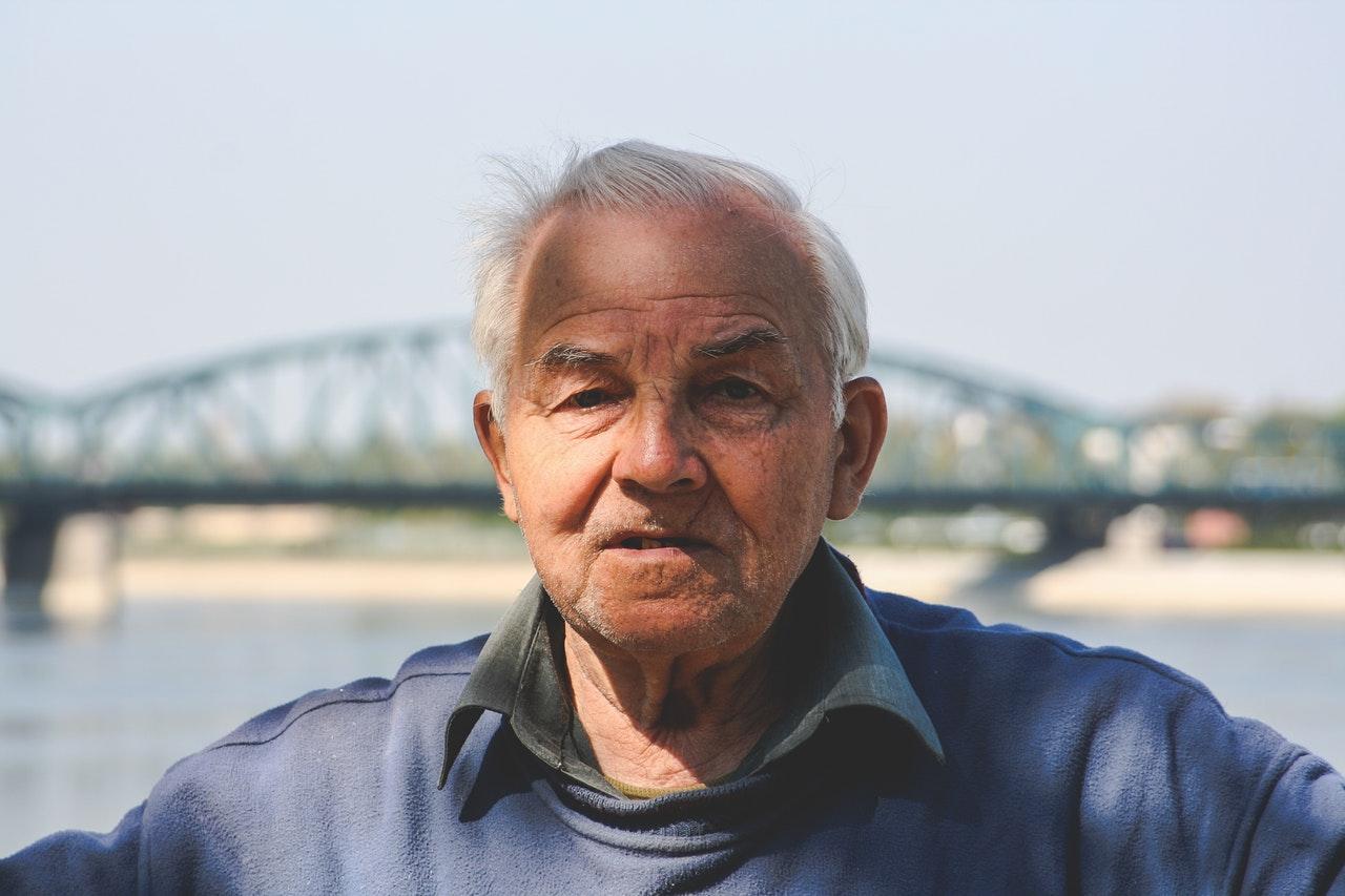 senior man by bridge.jpg