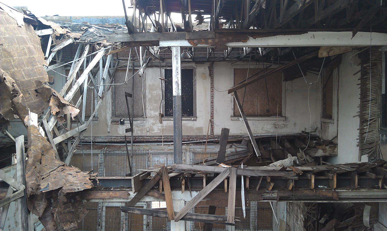 A former cotton exchange building after the roof collapsed into the second floor and turned the back half of the building into a pile of rubble.