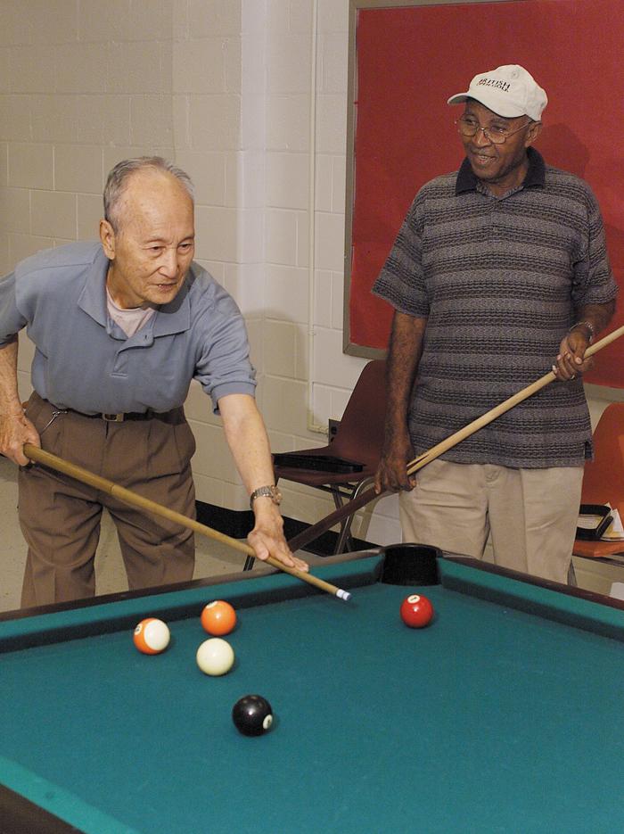 Two men playing pool