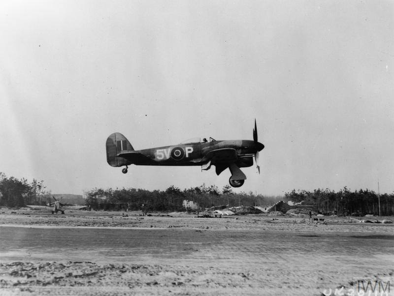 A Hawker Typhoon fighter-bomber of 439 Squadron RCAF returns from a mission over enemy lines. © IWM (MH 6864)