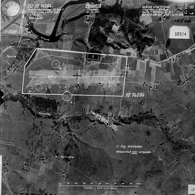 Aerial Image of Airfield in Lituania with notations indicating length of runway and anti-aircraft guns.  Source: Aerial Photographs, compiled 1935–1970; Records of the Defense Intelligence Agency, Record Group 393; National Archives at College Park, College Park, MD.