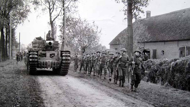 Soldiers from 53rd (Welsh) Division advancing through Normandy in 1944.    The Regimental Museum of the Royal Welsh