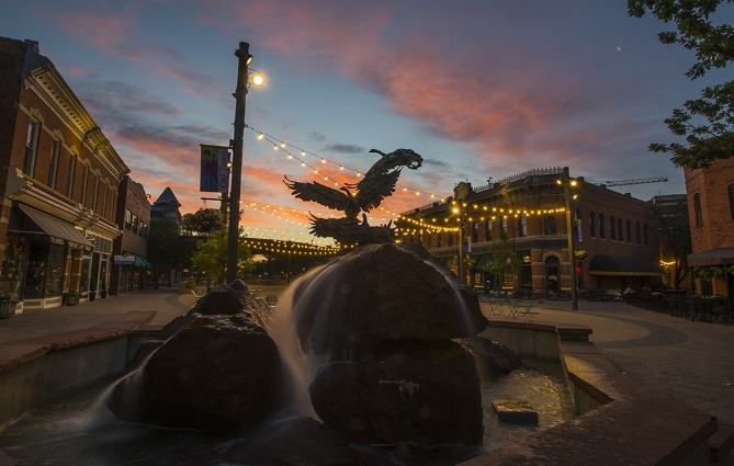 The sun sets over old town square in fort collins